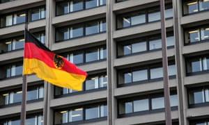 A German flag flies in front of the Bundesbank headquarters in Frankfurt, Germany.