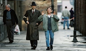 Roman Polanski directs Adrien Brody in The Pianist (2002), set in the Warsaw ghetto