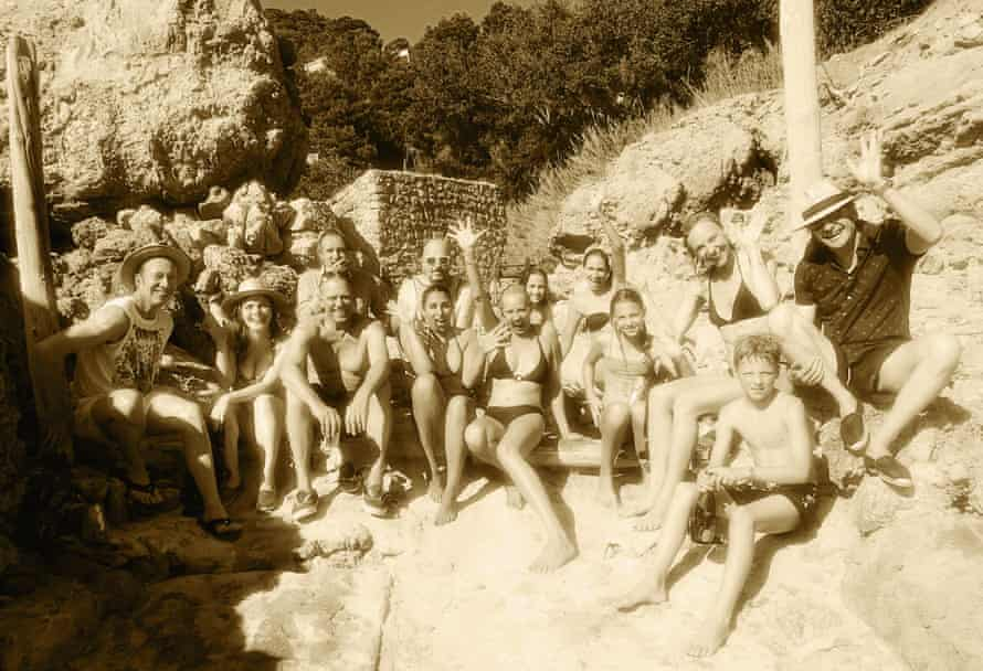 Ellen von Unwerth's summer snap, 2016. Left to right: Stuart Matthewman, music producer; Syrie Moskowitz, actress and model; Paul Simonon, of the Clash; Rhys Ifans, actor; Serena Rees, creator of Agent Provocateur; Jake Chapman, artist; Sara Ball, architect; Rosemary Ferguson, model, pictured with daughter; Cathy Kasterine, stylist, pictured with son and daughter; Christian Fourteau, music producer.
