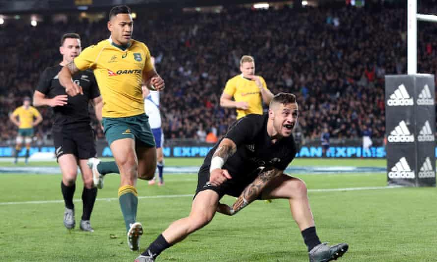 All Black TJ Perenara celebrates a try against Israel Folau's Australia