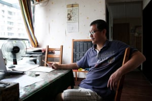 Duan Peng looks on at home in Shenzhen, Guangdong, China.