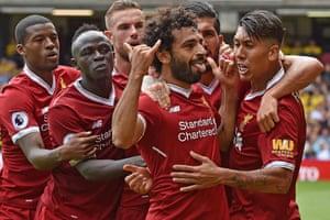 Salah celebrates with teammates.