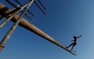 A competitor falls off the gostra, a pole covered in lard, during the celebrations for the religious feast of St Julian in Malta