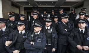 Police form a cordon around the Grand Connaught Rooms as protesters gather