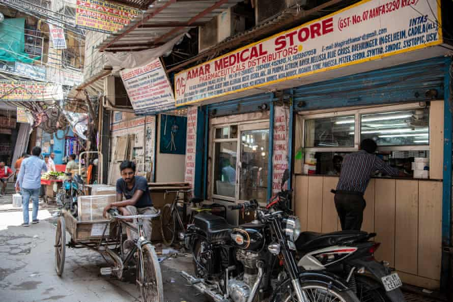 A man buys medicine from a shop at Bhagirath Palace's pharmaceuticals market in Old Delhi.