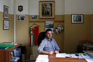 Santo Stefano has just 108 inhabitants, less than a tenth of its pre-World War One population, according to Mayor Fabio Santavicca, pictured in his town hall office
