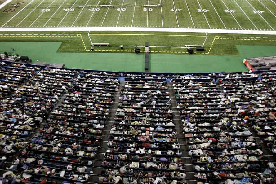 Thousands of displaced residents take cover from Hurricane Katrina at the Superdome in New Orleans, Louisiana, on 28 August 2005.