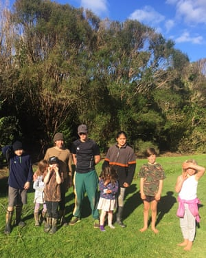 Joey Moncarz and children who attend the Deep Green Bush School in New Zealand.