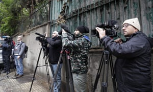 Members of the press wait in front of a house identified by court documents as belonging to former Nissan chief Carlos Ghosn in a wealthy neighbourhood of the Lebanese capital Beirut today