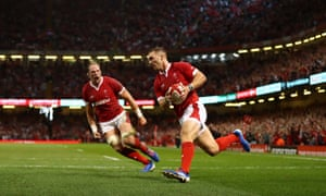 Wales's George North runs in the only try of the match against England in Cardiff as his captain Alun Wyn Jones roars his approval.