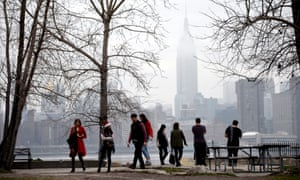 People walk through a park along the East River during an unseasonably warm Christmas Day this year, when temperatures reached near 20C.