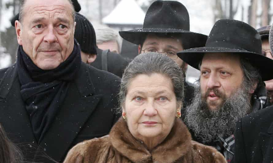 Simone Veil with President Jacques Chirac, left, in 2005, visiting the former Auschwitz death camp where she had been held in 1944, to mark the 60th anniversary of the liberation of Auschwitz-Birkenau.