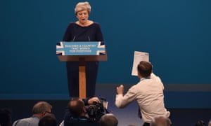 Simon Brodkin approaches Theresa May with a P45