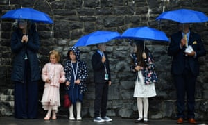 People shelter from the rain in Knock, Ireland