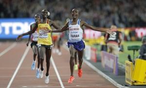 Mo Farah crosses the line to take gold.