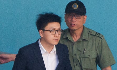 Edward Leung crosses the prison yard to board a bus to take him to Hong Kong's high court for sentencing