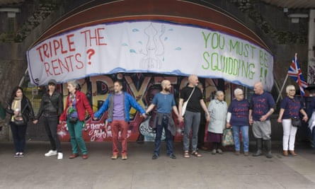 Protesters under the railway arches on Atlantic Road, Brixton.
