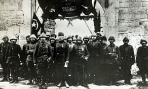 The opening of a Turkish munitions factory behind the lines showing the assembled Turkish military.