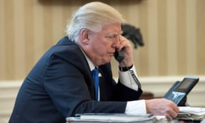 Donald Trump speaks to Angela Merkel on the phone in the Oval Office on Saturday.