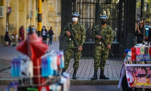 Colombian soldiers wear protective face masks in Bogota.