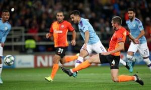 Ilkay Gundogan of Manchester City scores his team's second goal during the 3-0 win over Shakhtar Donetsk at Metalist Stadium in Kharkiv.