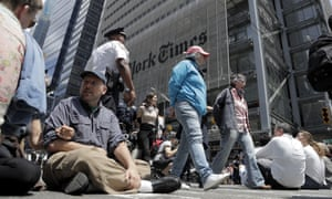 Climate activists outside the New York Times building in June
