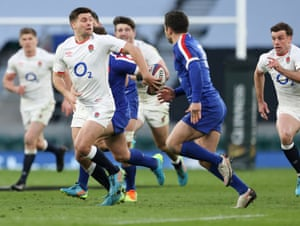 Ben Youngs of England hands the ball off.