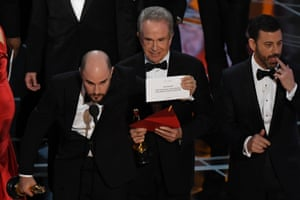 US actor Warren Beatty shows the card reading Best Film Moonlight after La La Land was mistakenly read out