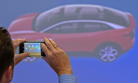 A journalist takes a photo at a Volkswagen AG electric car presentation