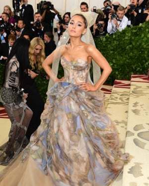 In a dress. Not distress … Ariana Grande.