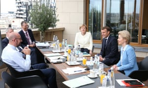 European council president Charles Michel (left), Germany's chancellor Angela Merkel (third left), French president Emmanuel Macron (second right) and European commission President Ursula von der Leyen (right) during a meeting on the third day of an EU summit in Brussels, Belgium, on 19 July