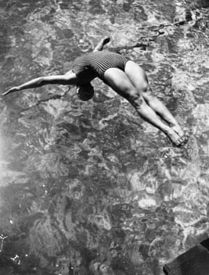 Betty Slade, Great Britain's champion diver, performing a back dive during a training session at Wood Green baths, London, in 1939