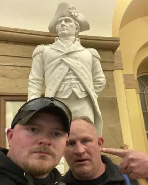 Thomas TJ Robertson and Jacob Fracker in the Capitol in the Capitol on 6 January.
