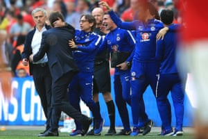 Jose Mourinho and Antonio Conte embrace after the match.