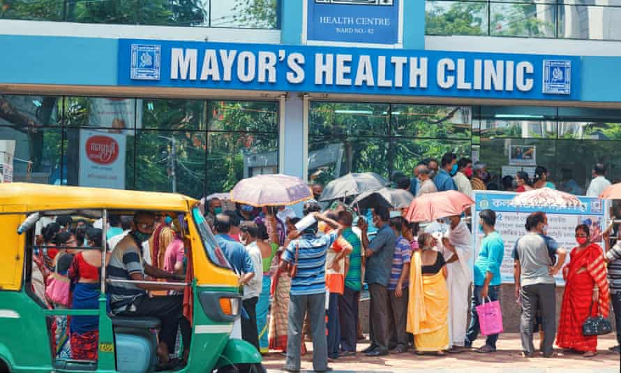 People queue outside a Covid-19 vaccination centre in Kolkata on 24 April
