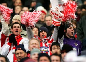 Exeter City fans look on in jubilant mood during the FA Cup third round match against Manchester United in 2005