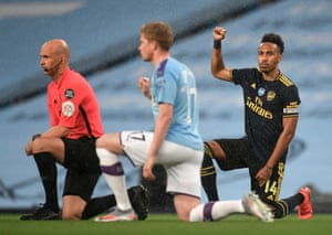 Arsenal's Pierre-Emerick Aubameyang takes a knee alongside Manchester City's Kevin De Bruyne before the match at the Etihad Stadium.