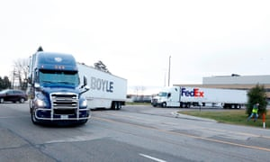 Trucks carrying the first shipment of the Covid-19 vaccine that is being escorted by the US Marshals Service, leave Pfizer's Global Supply facility in Kalamazoo, Michigan.