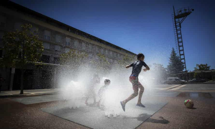Children play in a jet stream fountain in Pamplona, Spain.