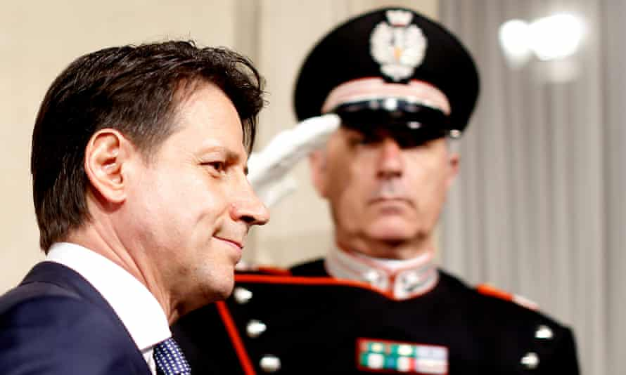 A salute for Giuseppe Conte, Italy's prime minister to be, as he arrives at Rome's Quirinal Palace