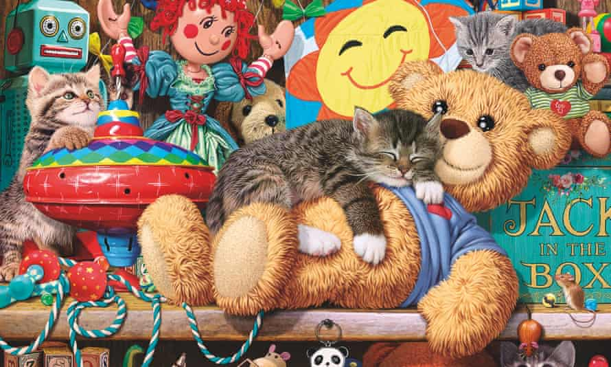 Some kittens explore a child's toy cupboard. One is taking a nap on a lovely soft teddy bear.