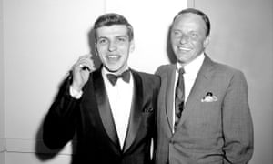 Frank Sinatra Jr with his father after a performance at the Hotel Americana, New York, 1963.