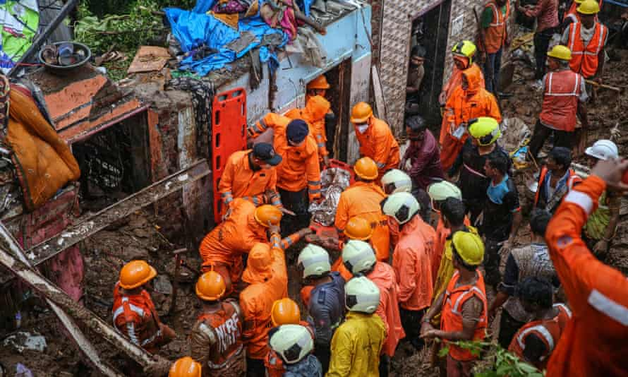 National Disaster Response Force personnel recover dead body from the rubble during a rescue operation in the aftermath of a landslide at a Bharat Nagar slum in Chembur, Mumbai