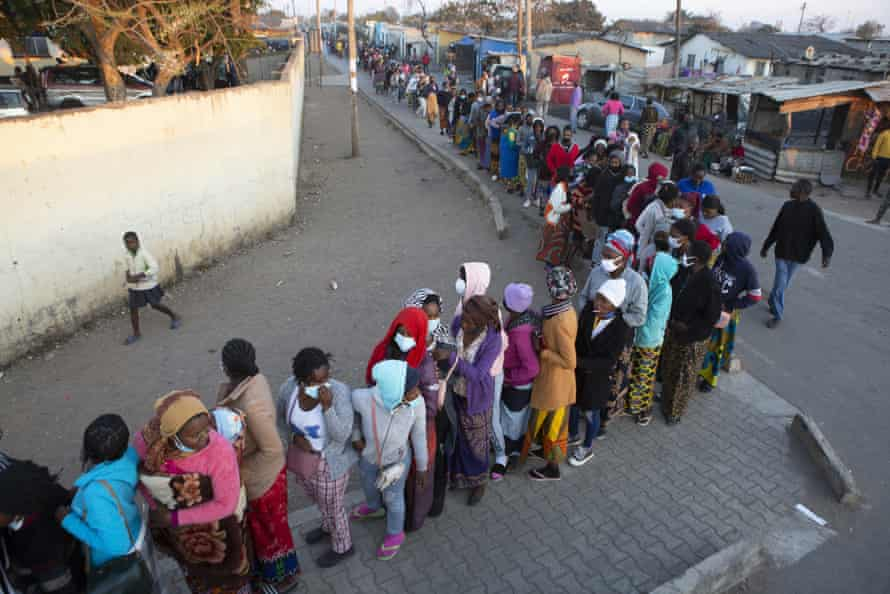 People wait in a queue at a polling station in Lusaka, Zambia on 12 August.