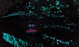 Tourists looking at glowworm cave, Waitomo caves, New Zealand.