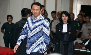 Governor Basuki Tjahaja Purnama, popularly known as Ahok, arrives at a courtroom for his verdict and sentence in his blasphemy trial in Jakarta on 9 May