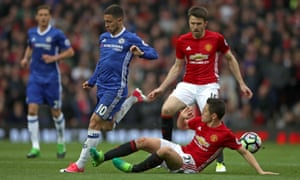 Chelsea's Eden Hazard, left, could not escape the attentions of Ander Herrera, right, at Old Trafford, while Michael Carrick also came off the bench to help Manchester United close out the game.