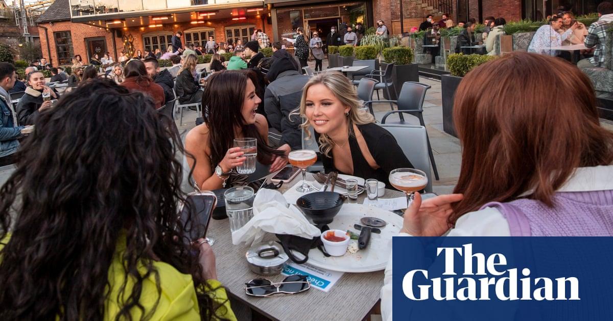 'Very celebratory': pub customers in England enjoy lockdown easing