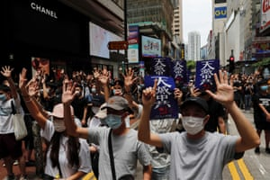 Anti-government protesters walk through the streets of Hong Kong.