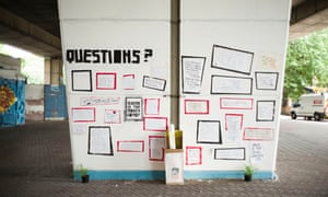 Wall of questions near the Grenfell Tower in Latimer Road, west London.